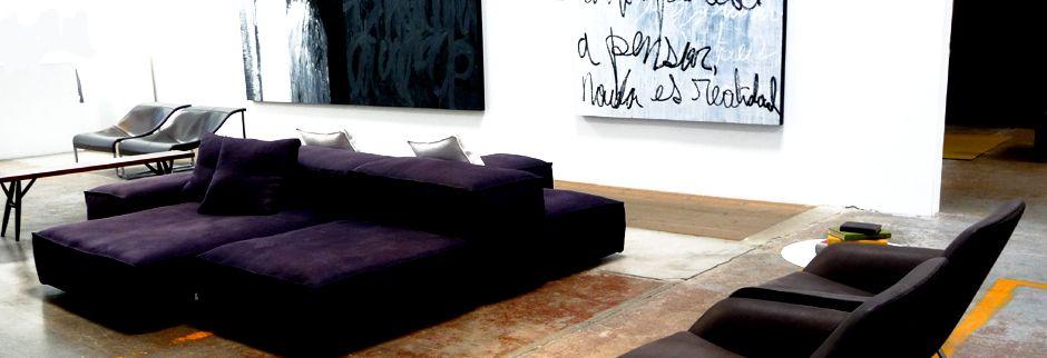 2 sided sofa dzine showroom living divani extrasoft by for Showroom divani milano