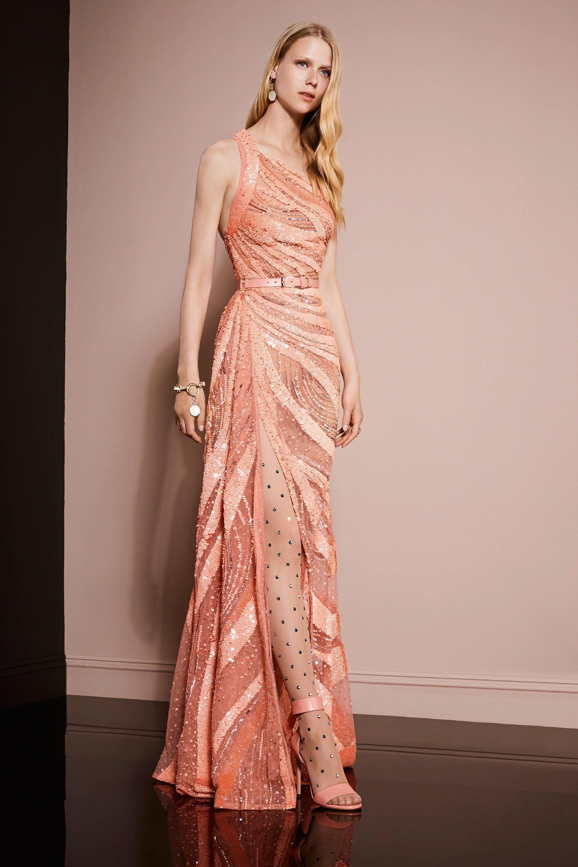 2c49794f5124 Elie Saab Resort 2018  I m obessed with this peach one shoulder dress with  intricate beading and side slit!