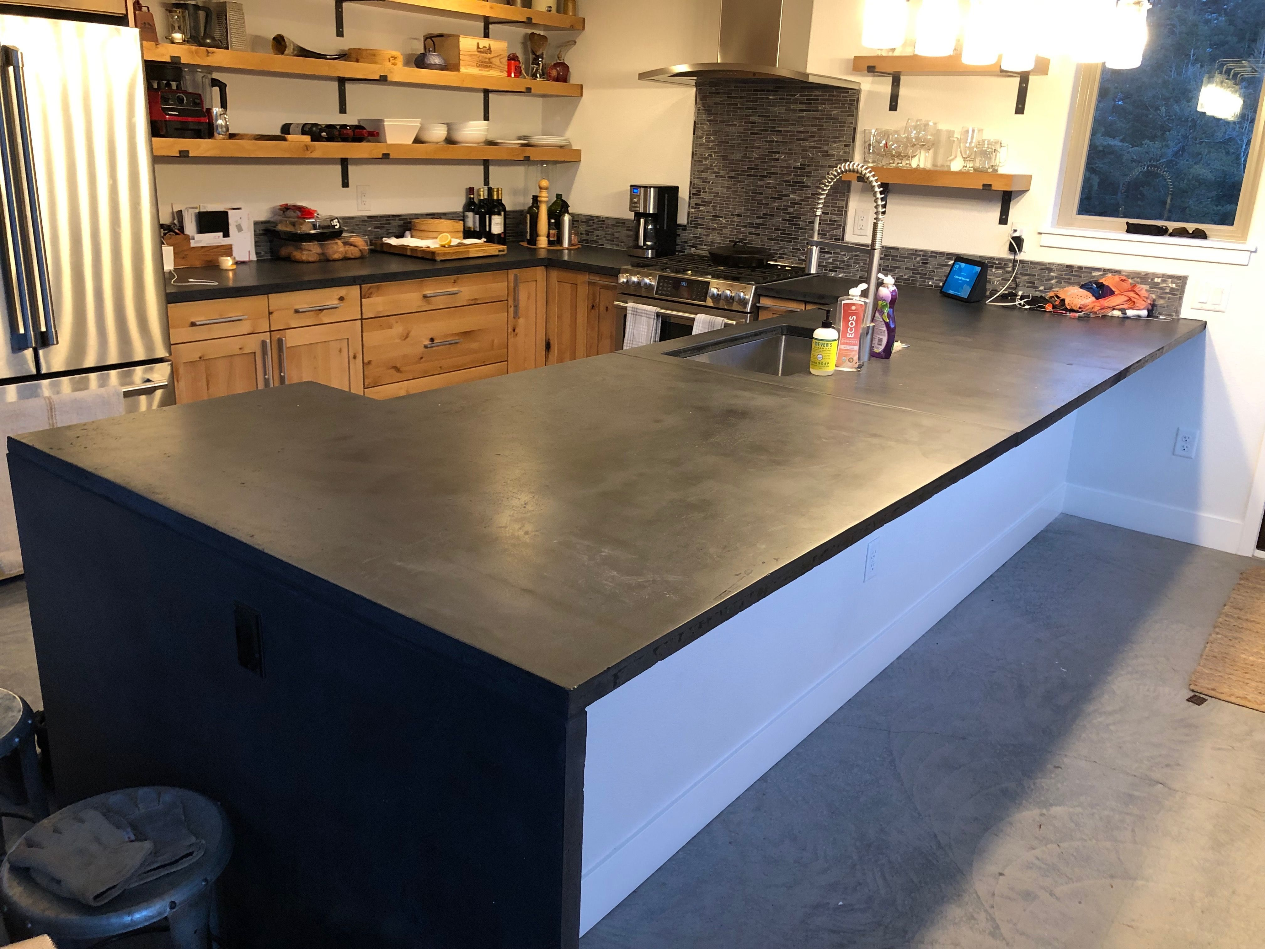 Custom Black Concrete Kitchen Countertop With Waterfall Edge Created By Dudley Design Llc