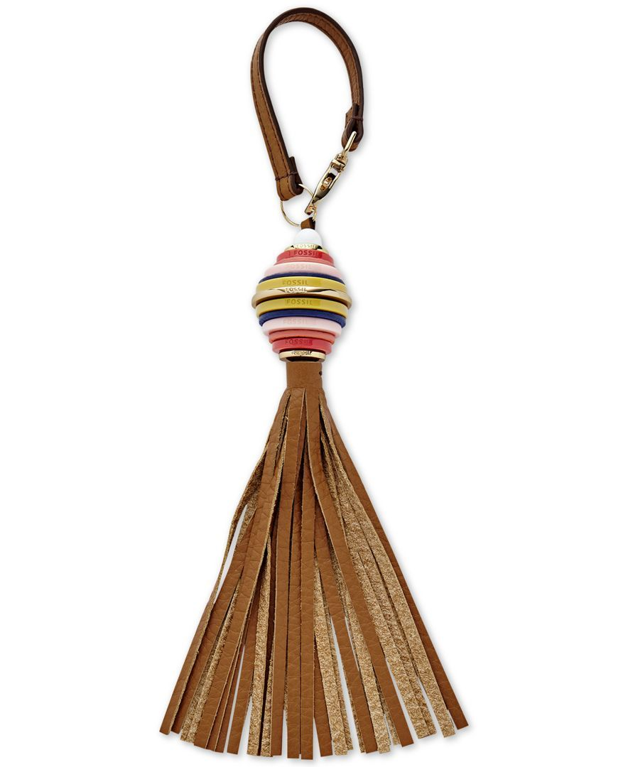 "Add a touch of boho-chic appeal to your handbag or keys with Fossil's bag charm, featuring a leather tassel and gleaming metallic hardware. | Leather | Imported | 2-1/2""W x 4-1/4""H x 3/4""D 