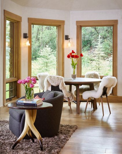 Contemporary dining room with modern, eclectic touches, featuring a