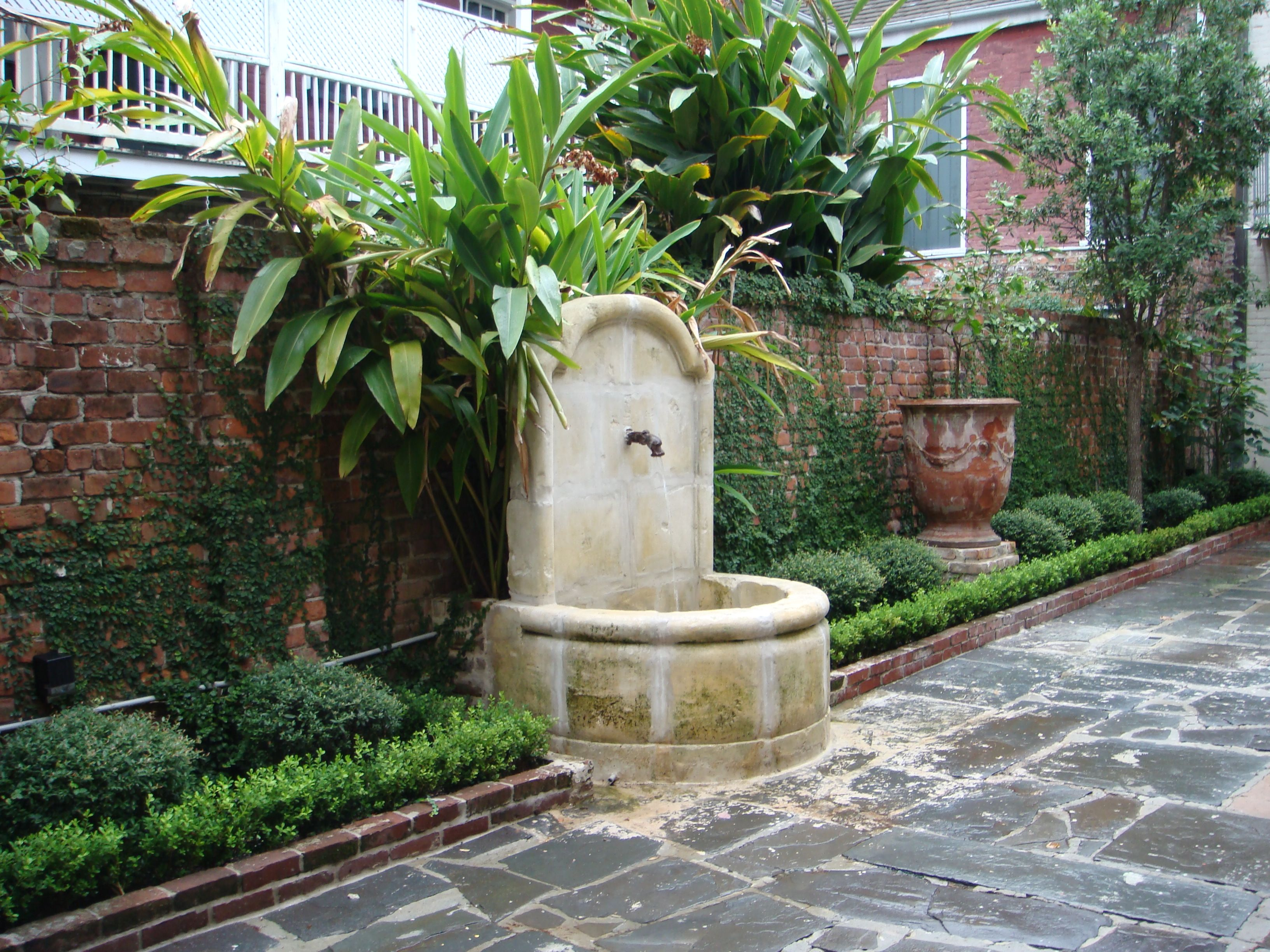 new orleans courtyard fountain wall i could live here