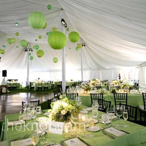 Green lanterns and linens filled the airy, white tent with the ...