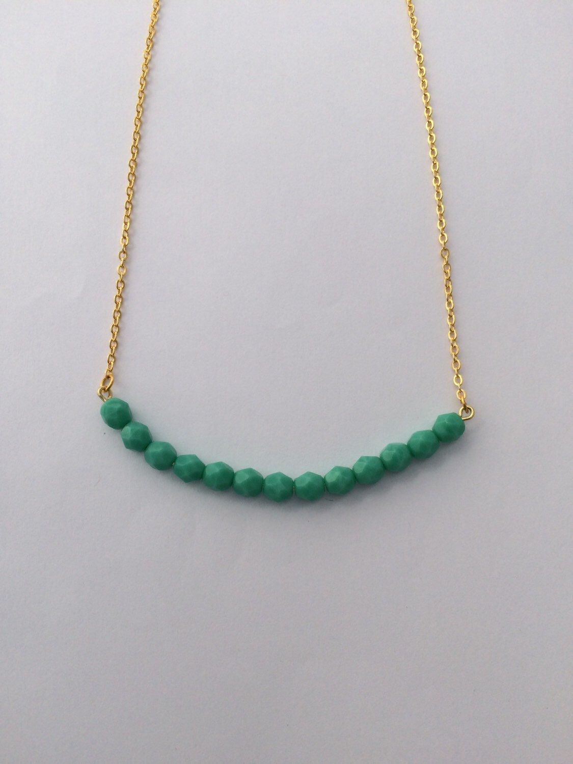 A personal favorite from my Etsy shop https://www.etsy.com/listing/234473279/turquoise-bead-bar-necklace