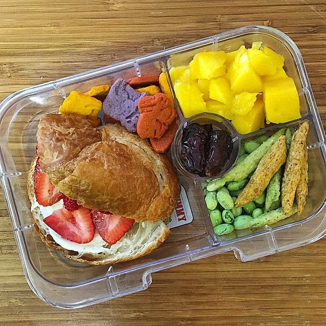 """#sofiaslunch for today also happens to be a #meatlessmonday! How about that. #yumbox packed with a strawberry cream cheese croissant, fruit and veggies crackers, mango, dried edamame lentil snaps and peas medley and some dates. #kindergartenlunch #schoollunch #eattherainbow #teachthemwell"" Photo taken by @sabrinamargaret on Instagram, pinned via the InstaPin iOS App! http://www.instapinapp.com (05/04/2015)"