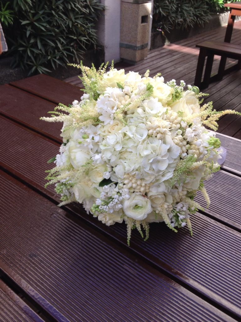 An All White Flowers Using Ranunculus With Sampaguita And Hydrangea
