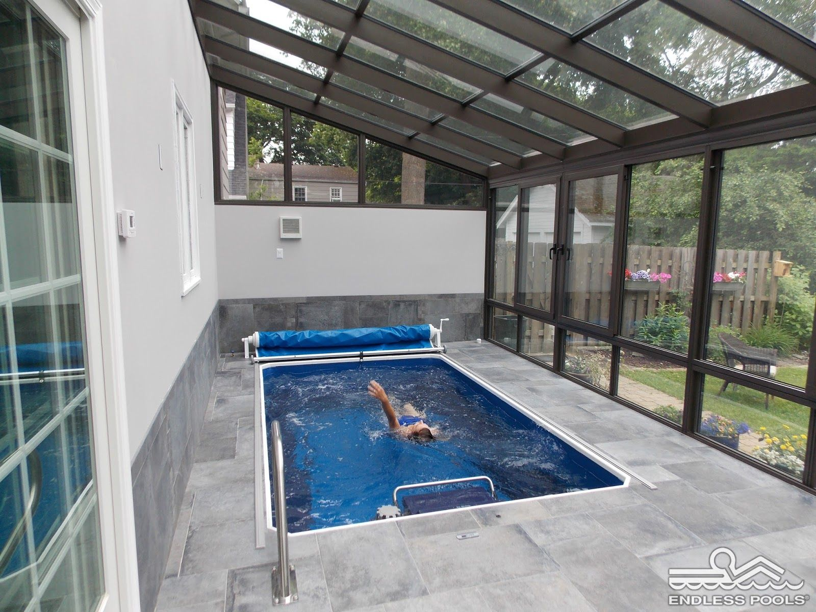 Pool with current to swim against - Pool Enclosures Make An Affordable Option For Year Round Swimming In A Sunroom Environment