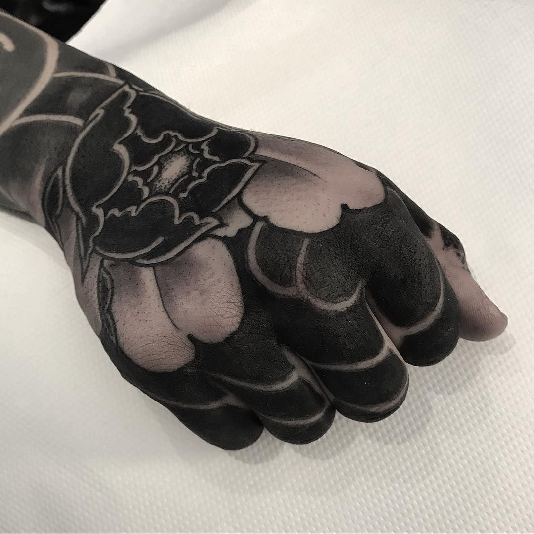 These Striking Solid Black Tattoos Will Make You Want To Go All In Japanese Hand Tattoos Hand Tattoos Black Tattoos