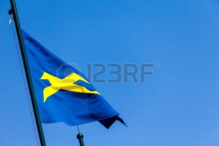 Stock photo available for sale at 123rf: Flag in the wind on blue sky background