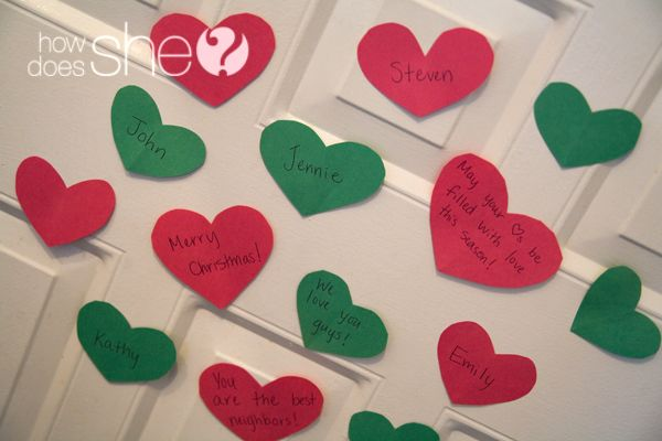 "You've probably seen paper ""heart attacks"" around Valentine's Day, but why not show your neighbors some love at Christmas time?  You and your family could make a bunch of Christmas coloured hearts and write little notes to your neighbors on them.   Then stick them on the front of their door for a fun Holiday Heart Attack surprise!