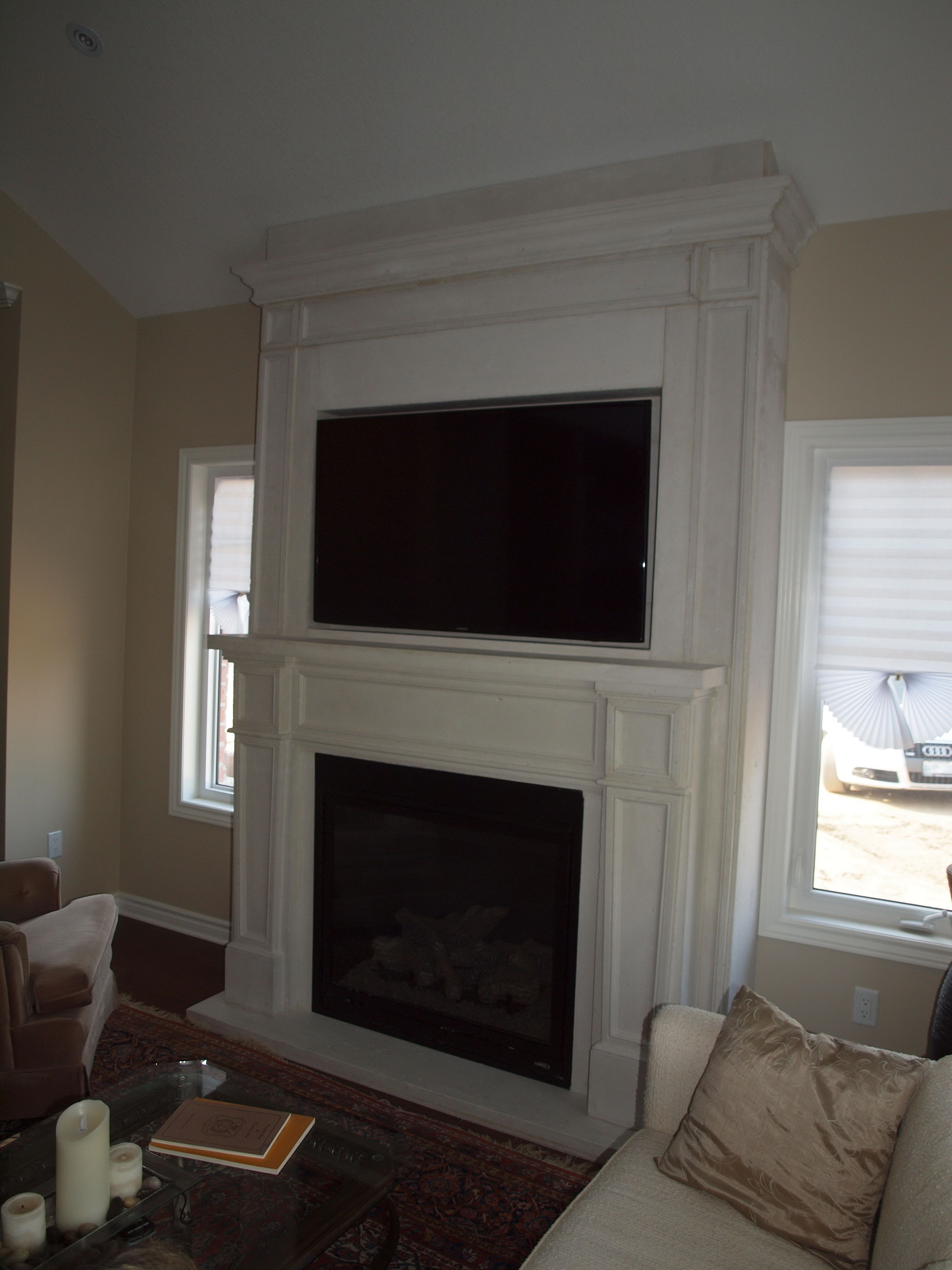 A lennox gas fireplace cast stone mantel and over mantel