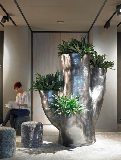 metallic tree planter with platicerum
