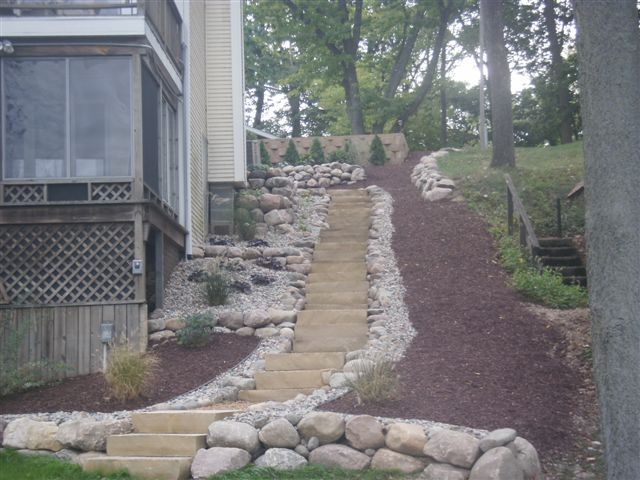 steppers lined with small stones create a great visual on extraordinary garden stone pathway ideas to copy id=60364