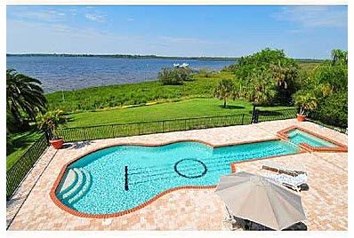 Guitar Shaped Pool Centerpiece Of Bradenton Fl Home Cool Pools Pool Pool Designs