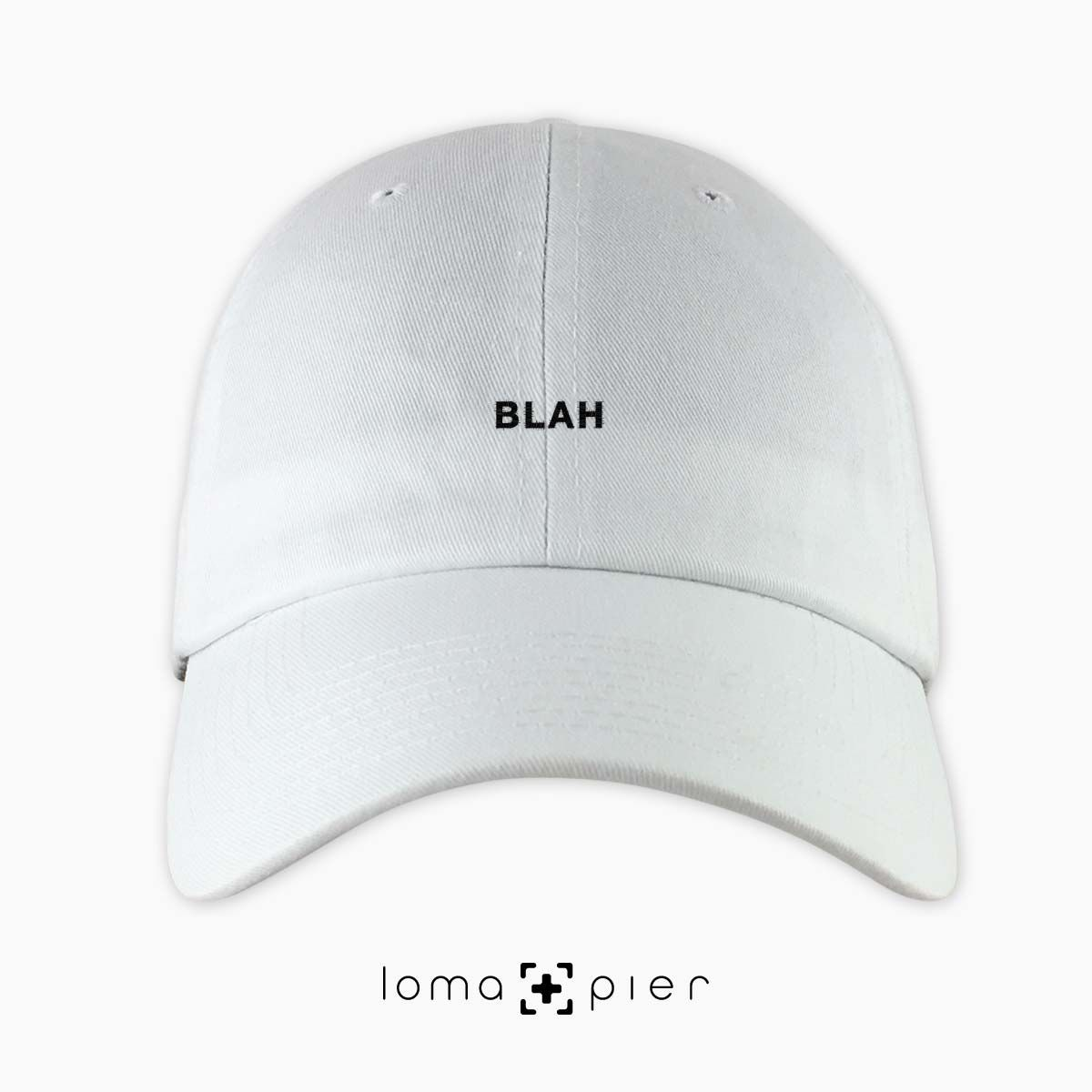 0d4ad574afb BLAH typography embroidered on a white unstructured dad hat with black  thread by loma+pier hat store made in the USA. BLAH dad hat is 100% cotton  ...