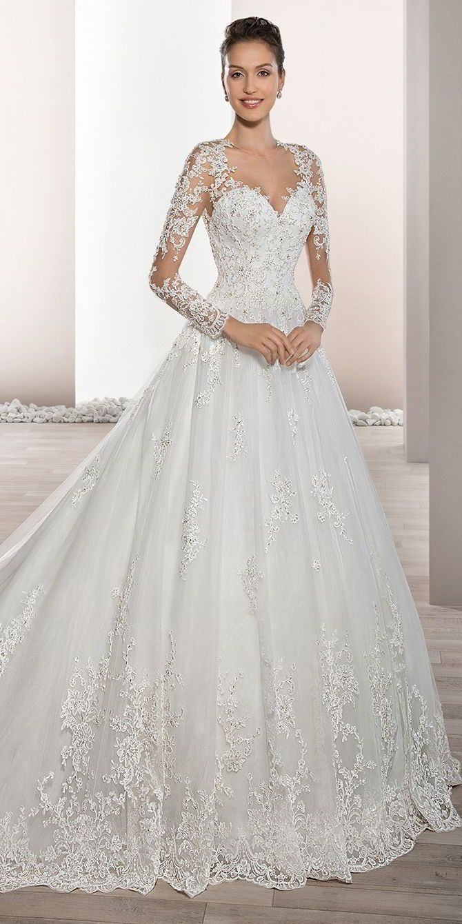 fbc62f6c4220 Delicately beaded appliques embellish this romantic Tulle Ball gown with  Sweetheart neckline and elegant sheer sleeves with lace accents that flow  into a ...