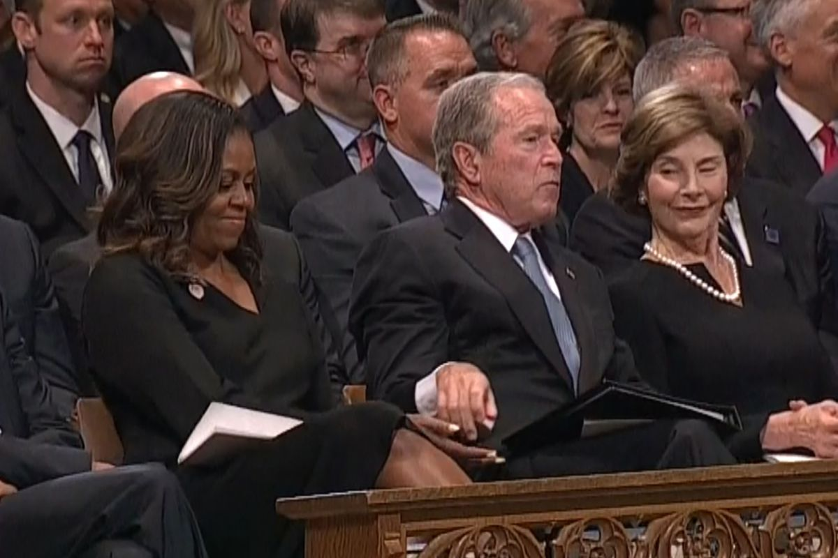 W. Bush, Michelle Obama share tender moment at