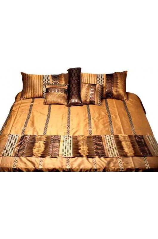 Brown Color Tuishaan Bed Sheet     Give a new dimension to your bed room with this awe-inspiring collection of bed embellishments. Inspired by the yesteryear Maharaja Lifestyle, this brown set with golden tinge looks monumental in every way. Add this to your collection and live life king size!