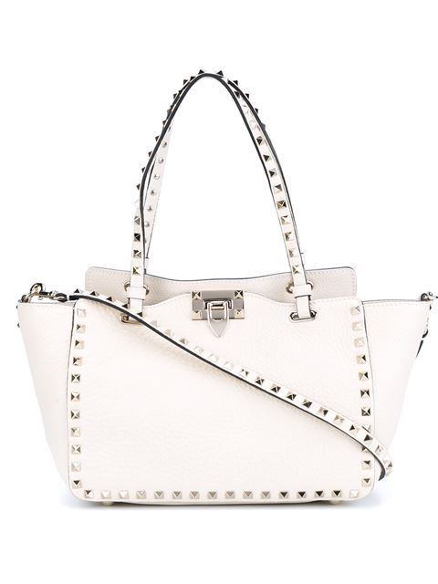 38f064d456b Shop Valentino Garavani small 'Rockstud' trapeze tote in Browns from the  world's best independent boutiques at farfetch.com. Shop 400 boutiques at  one ...