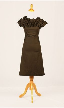 Petals bloom from the collar of this pine-colored frock.