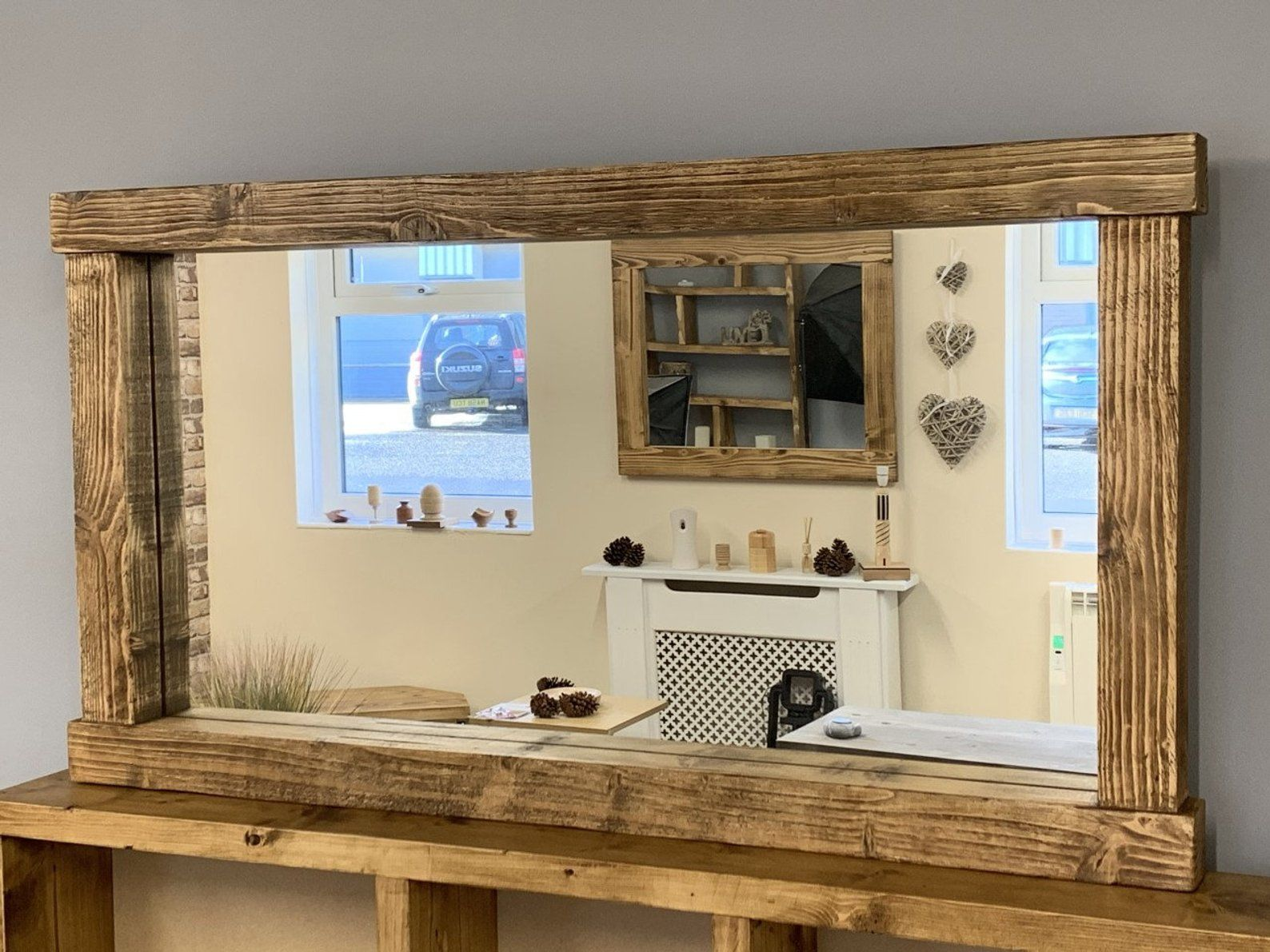 Rustic mirror with candle shelf made from reclaimed wood