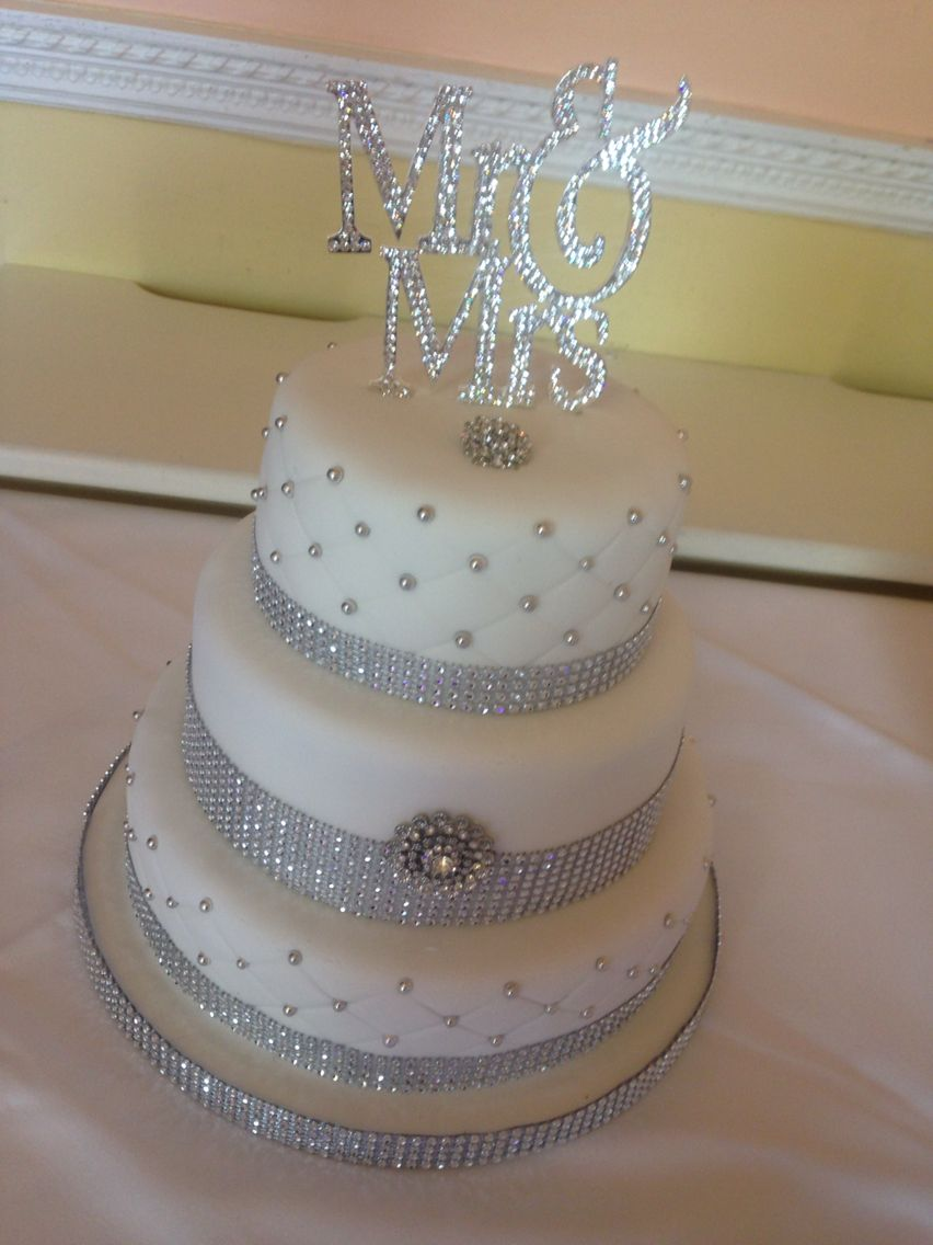 Bling bling and more bling tiered wedding cake with silver