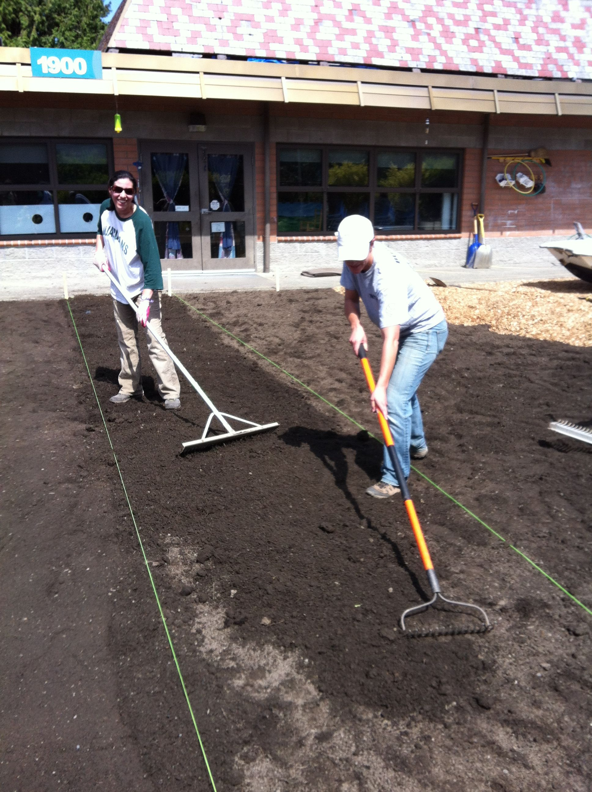 Raking Out The Topsoil In Preparation For The Sod Playground Design Natural Playground Playground