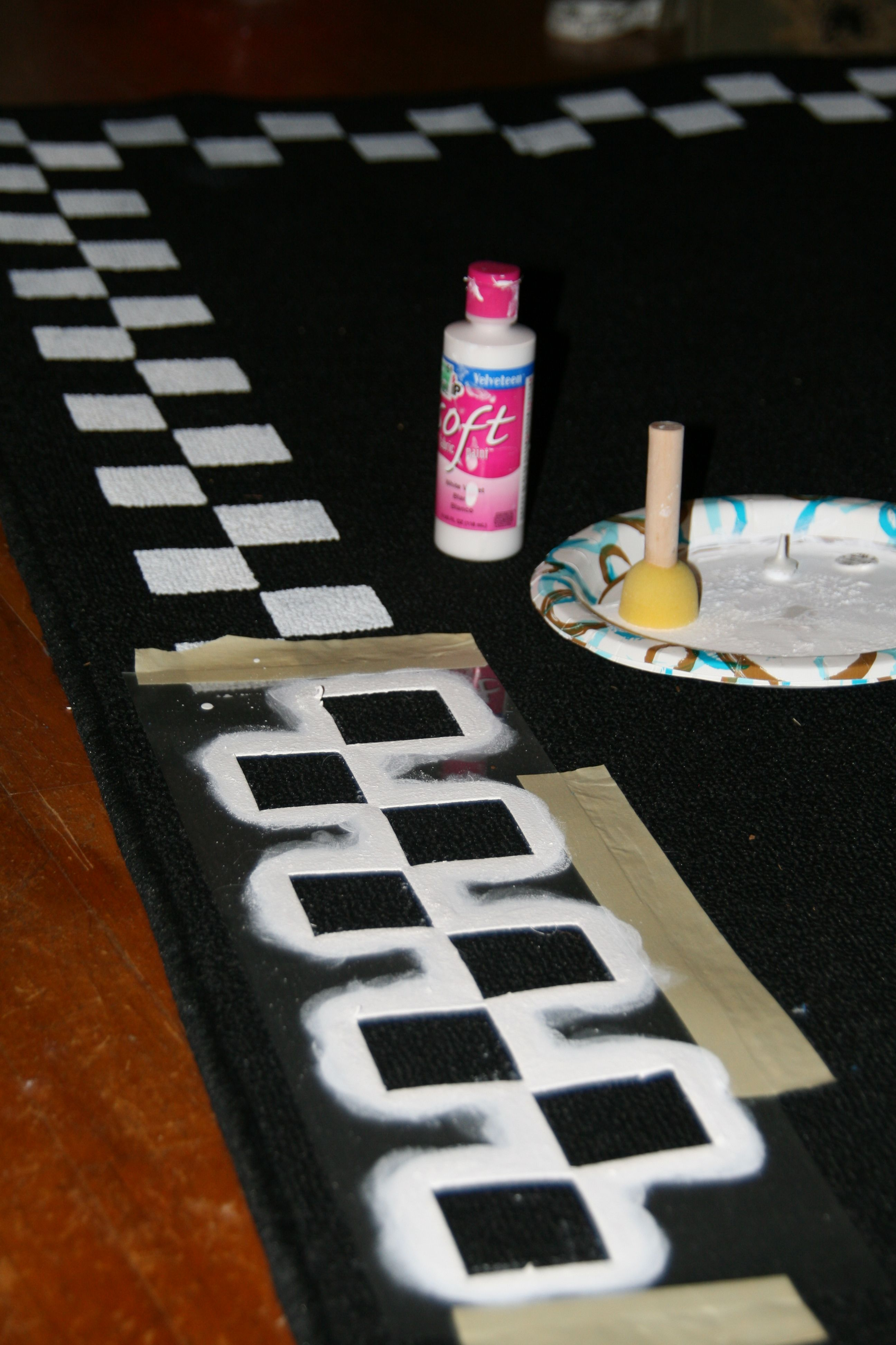 Checkered Design Stenciled On Inexpensive WalMart Rug To Be Used - Black and white check bath mat for bathroom decorating ideas