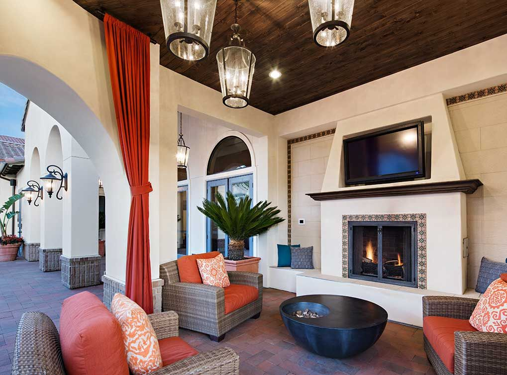 Enjoy the outdoor living area with a TV and fireplace at AMLI Spanish  Hills, luxury