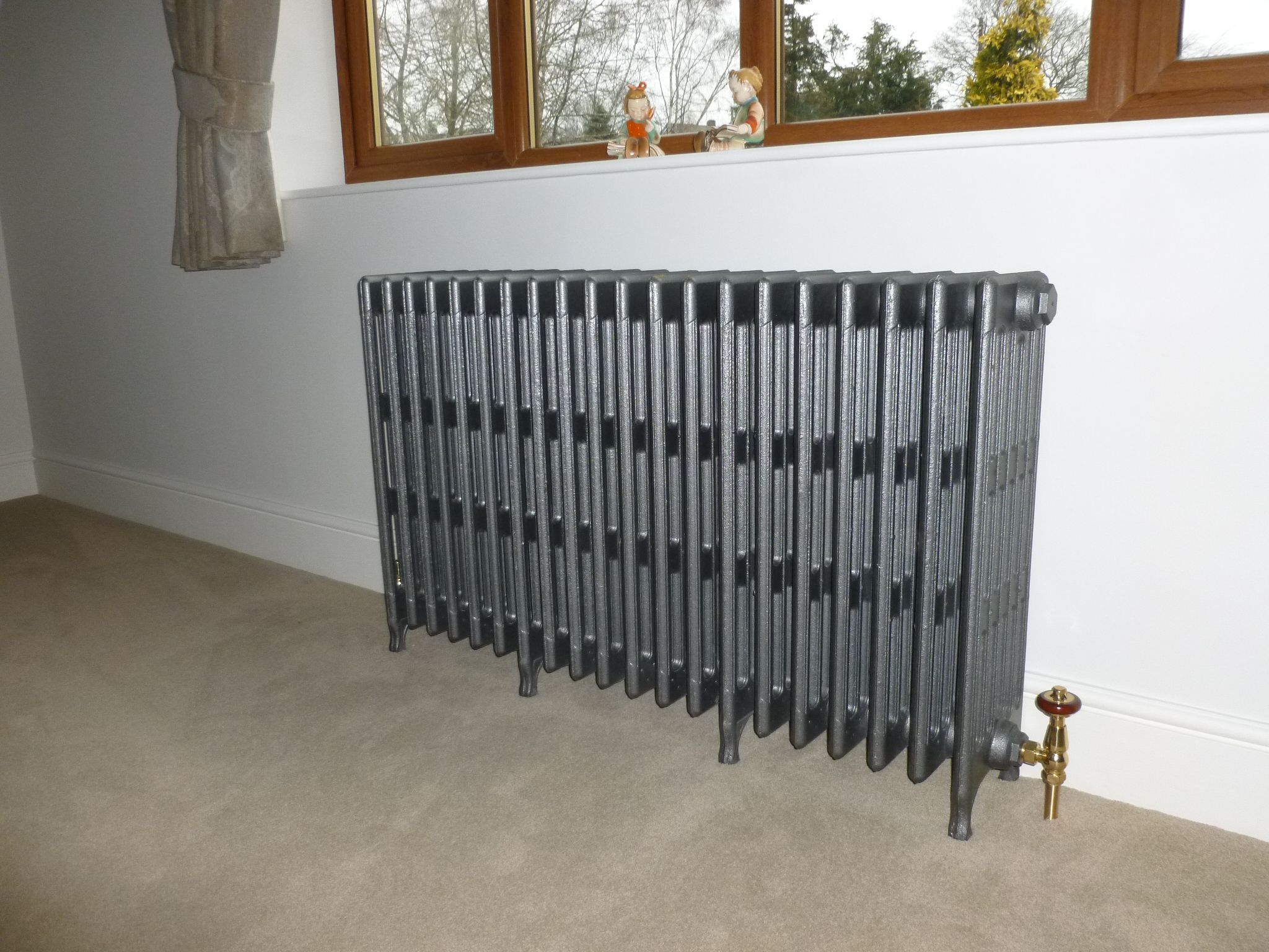 carron cast iron radiators sprayed in a foundry grey finish and