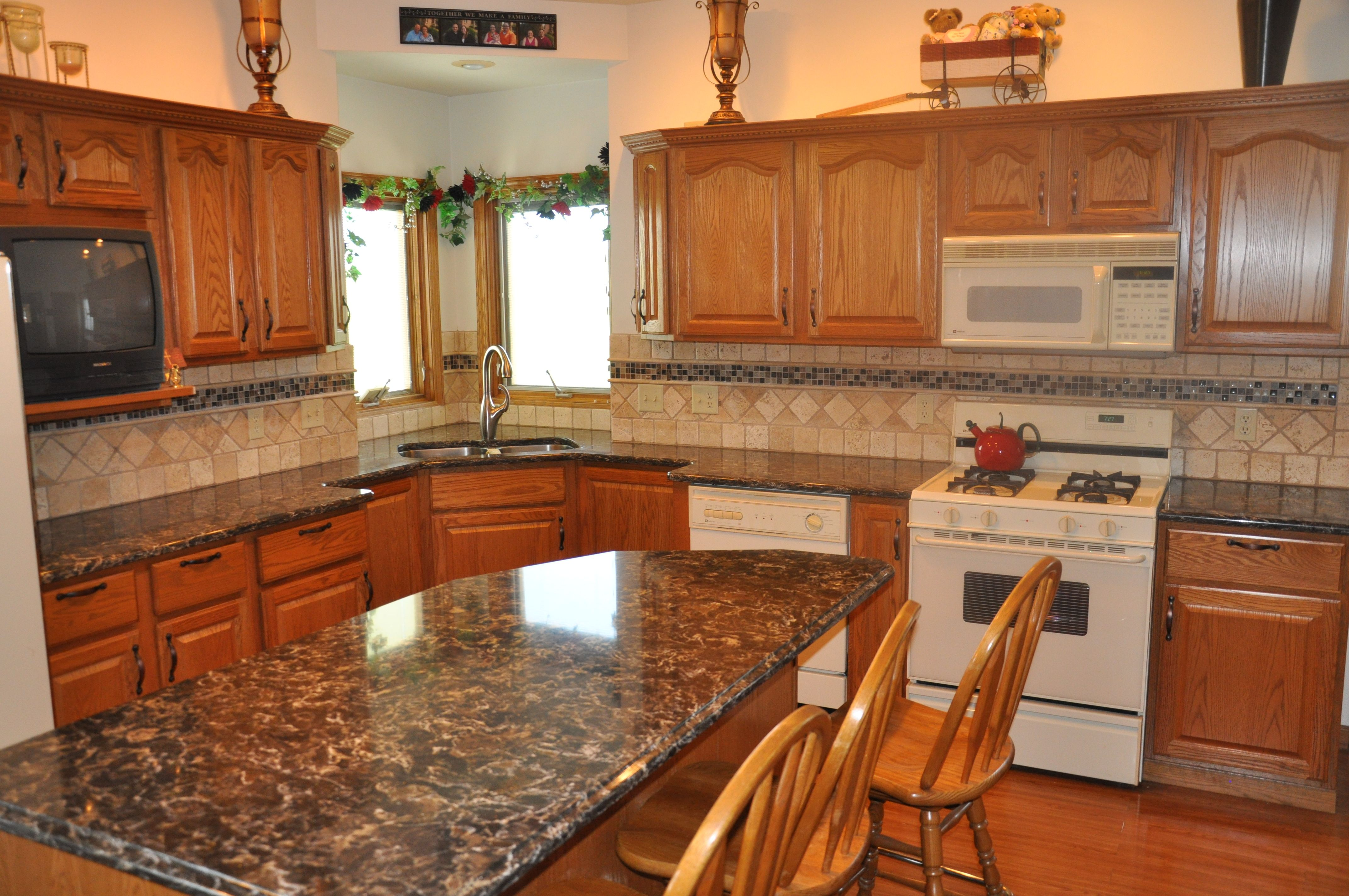 Oak Cabinets With Granite Countertops Pictures Cambria Quartz In Laneshaw Compliments Oak Cabinetry Very