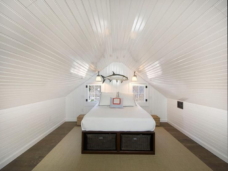 Cottage Attic Bedroom Features Beadboard Ceiling And Walls