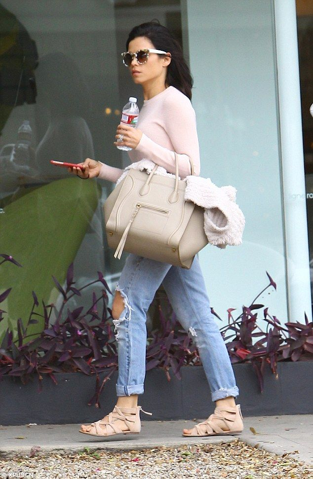 Pastel: She opted for a soft palette, with a pale pink sweater, biscuit-coloured bag and i...
