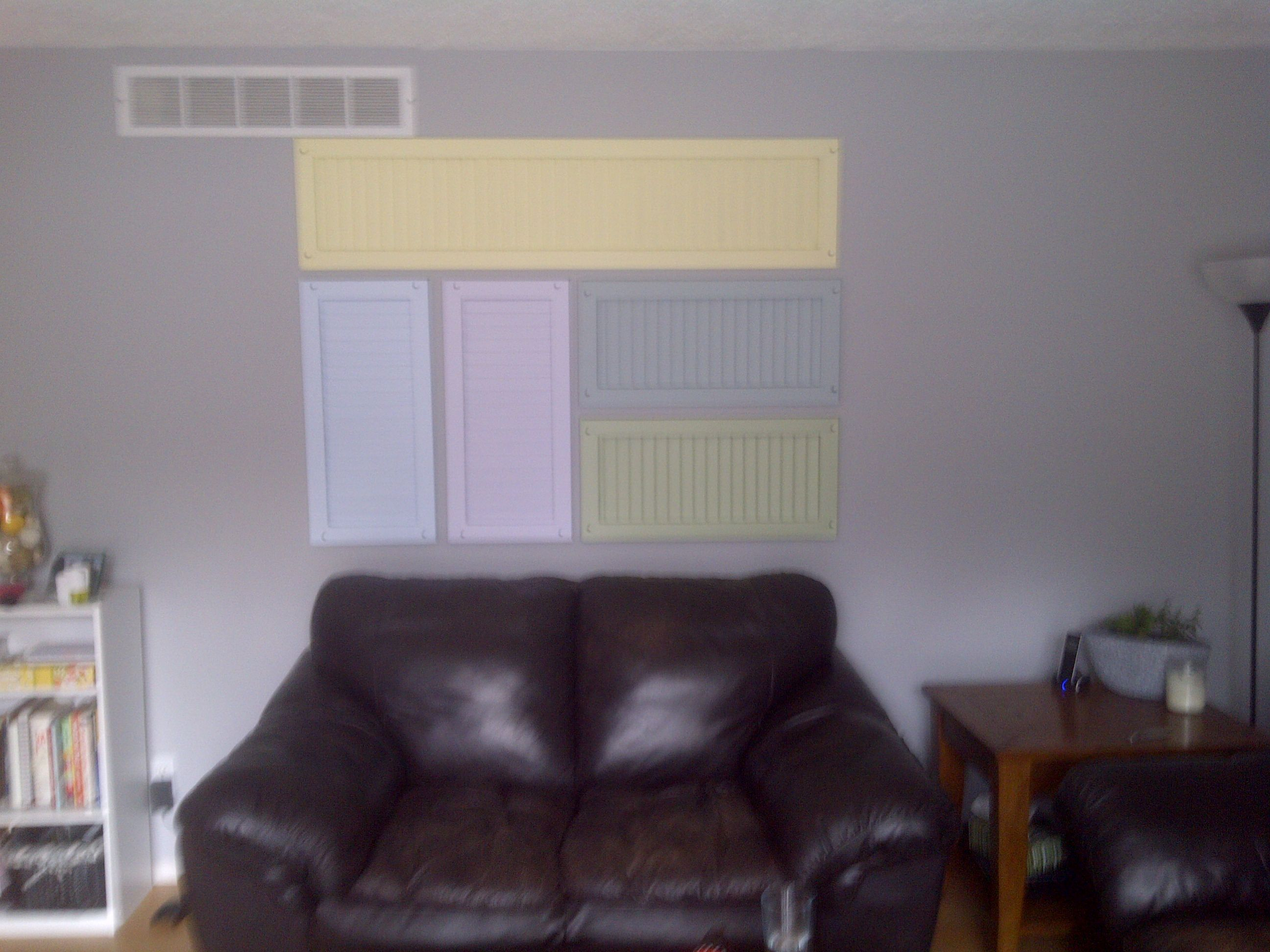 I recycled old metal shutters from my windows to add some character to my livingroom.