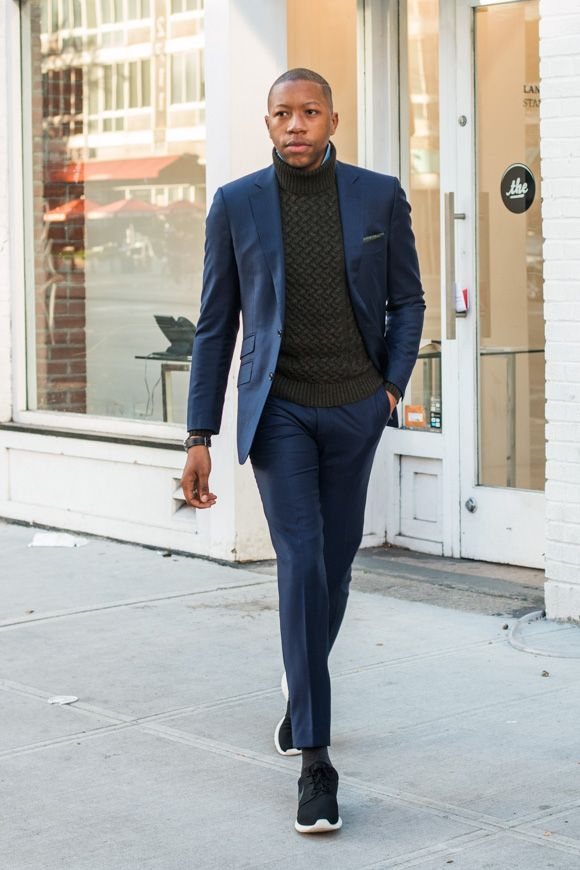 Trim,cut suit with a beefy turtleneck.