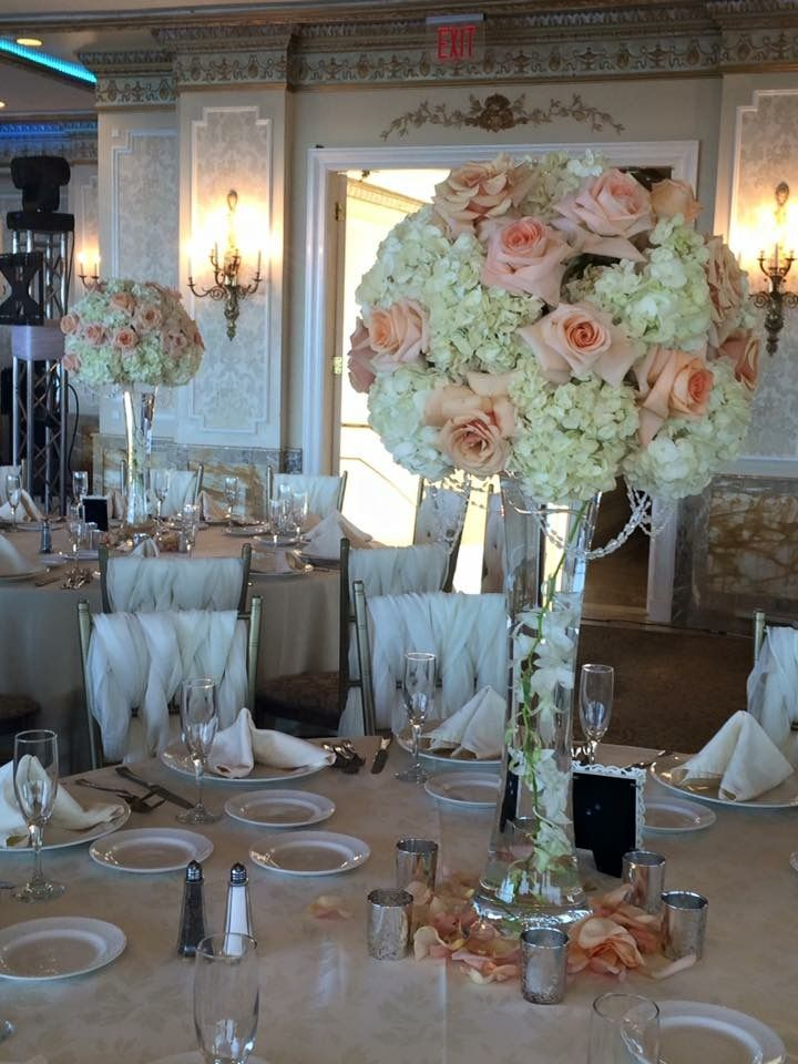 Flared Vase With White Dendrobium Orchids Inside And An Arrangement Of White Hydrangea Mother Rose Centerpieces Wedding Rose Centerpieces Rose Petals Wedding