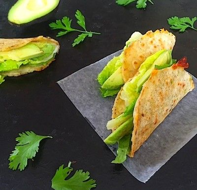 Crispy Avocado Tacos are a delicious study in texture: crispy corn tortillas with oozy melted cheese and creamy avocado, all finished with crunchy Romaine.