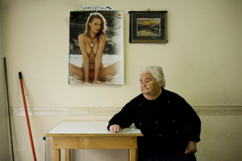 """""""mpdrolet:  A lady sitting in her sons garage, Barletta, Italy, December, 2006, from Friends  Enemies Reed Young  """""""