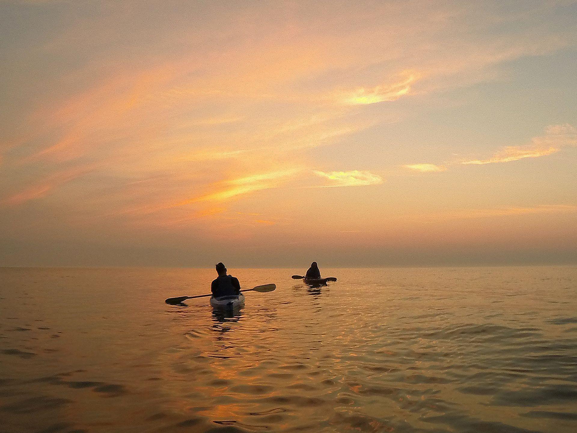 Kayakers paddle on Lake Michigan at sunrise in Cedar Grove, Wis.  Julio Cortez, AP