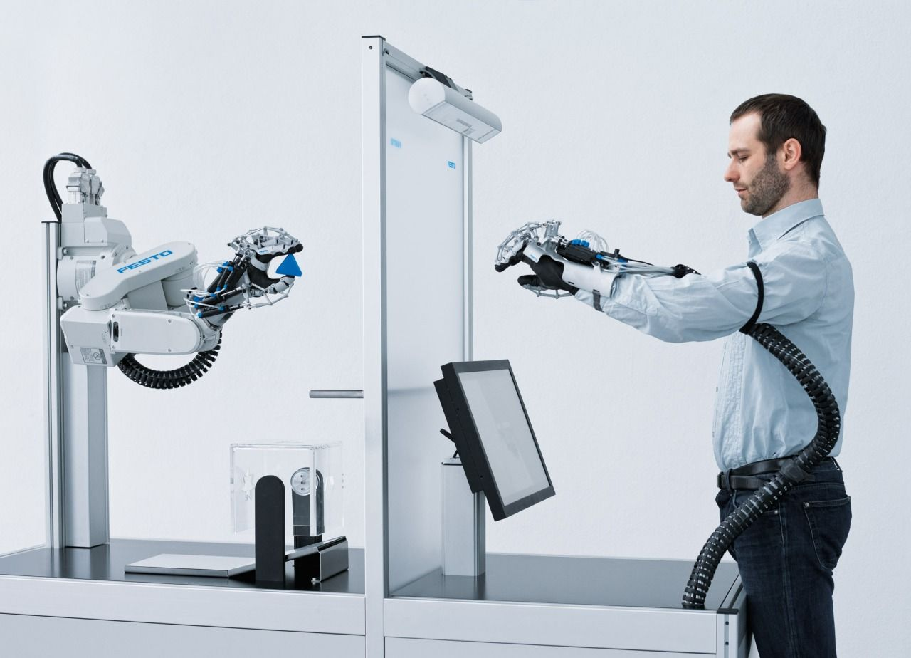 Festo's ExoHand http://www.makepartsfast.com/2012/05/3693/3d-printing-technology-helps-build-service-robot-exoskeleton/