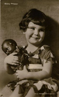 Baby Peggy Silent film star. This image speaks volumes for a child to have a black doll during that time. Love this!