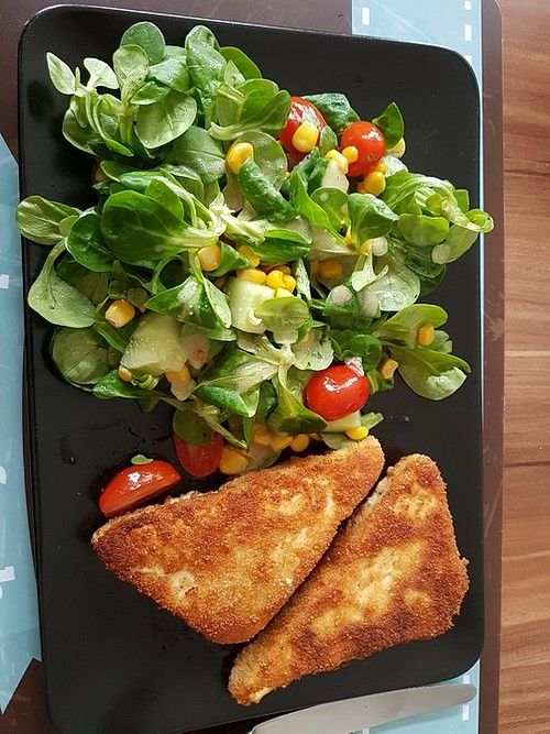 Photo of Baked feta cheese on mixed salad with honey dressing