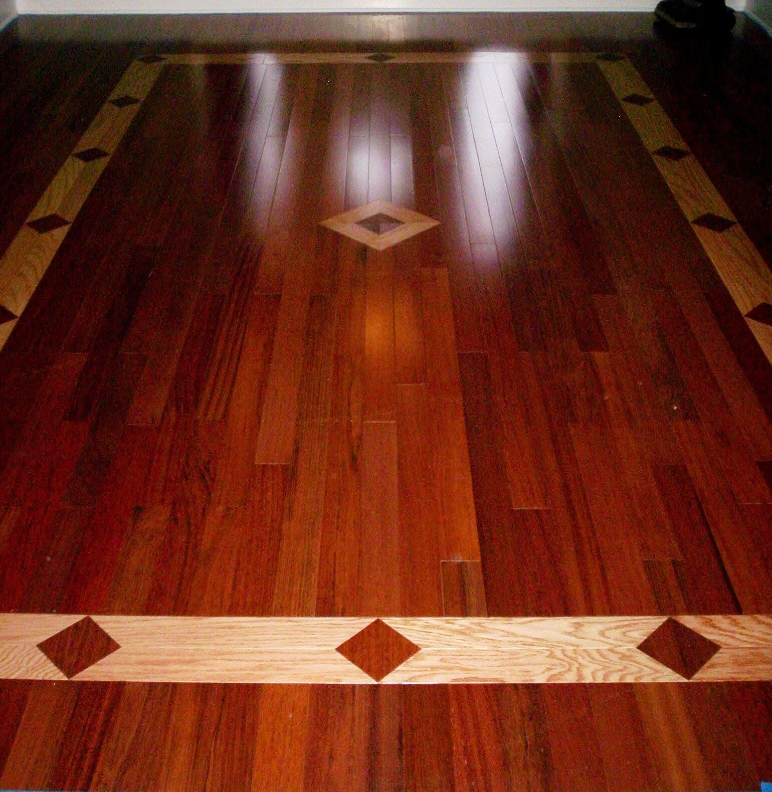 Brazilian cherry hardwood floor with a red oak inlay for Brazilian cherry flooring