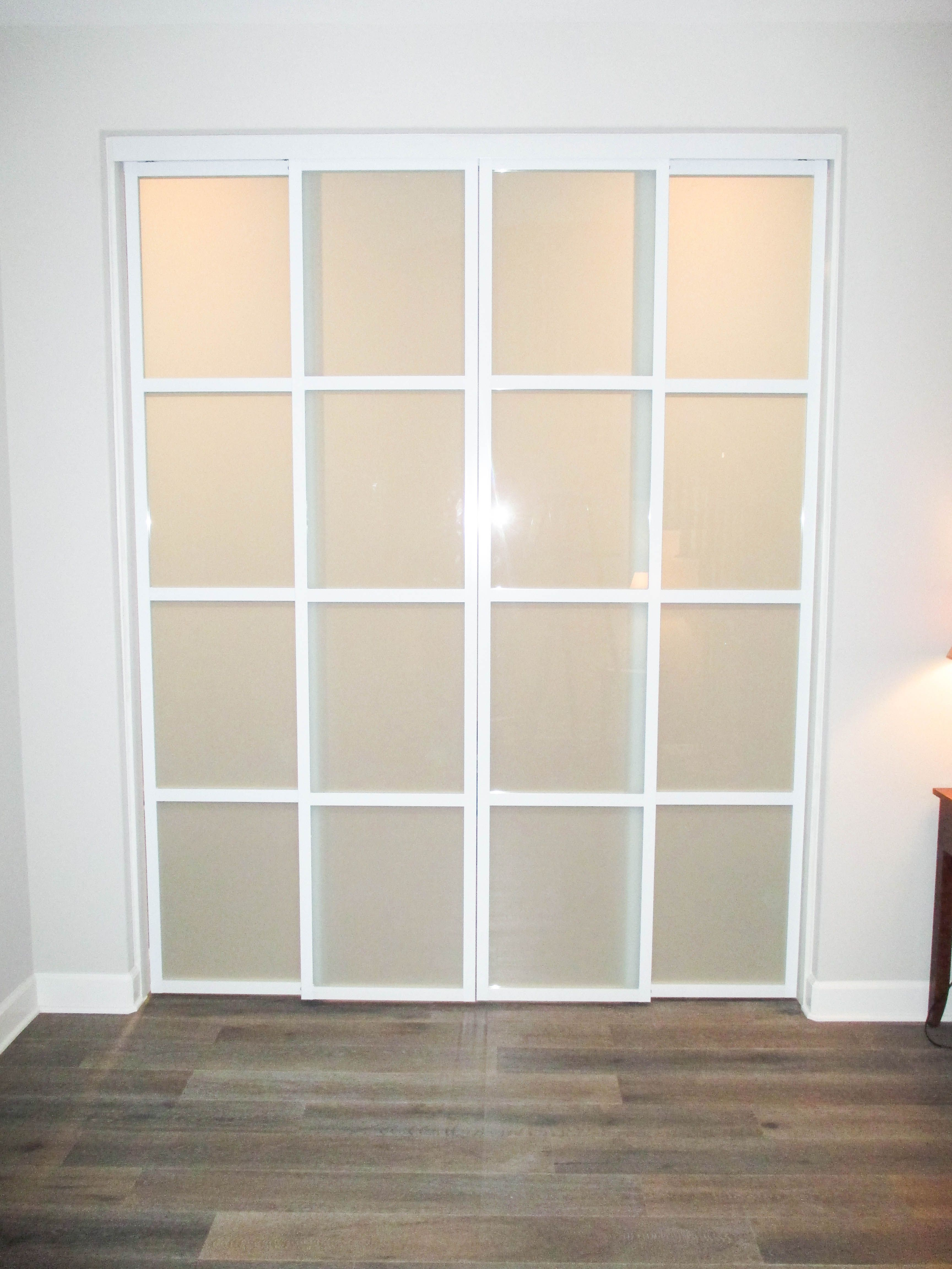 Our Team Installed This 4 Panel 2 Track Top Hung Aluminum Frame Room Divider With White Laminated Glass In Rancho Mis White Laminate Room Divider Linen Closet