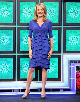 ADRIANNA PAPELL Royal blue cocktail dress w/jersey cross-over bodice, v-neckline, 3/4 sleeves, skirt in satin horizontal tiered ruffles | Vanna White's dresses | Wheel of Fortune