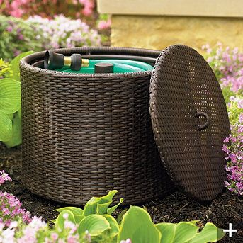 Use a large covered outdoor basket to store your garden hose