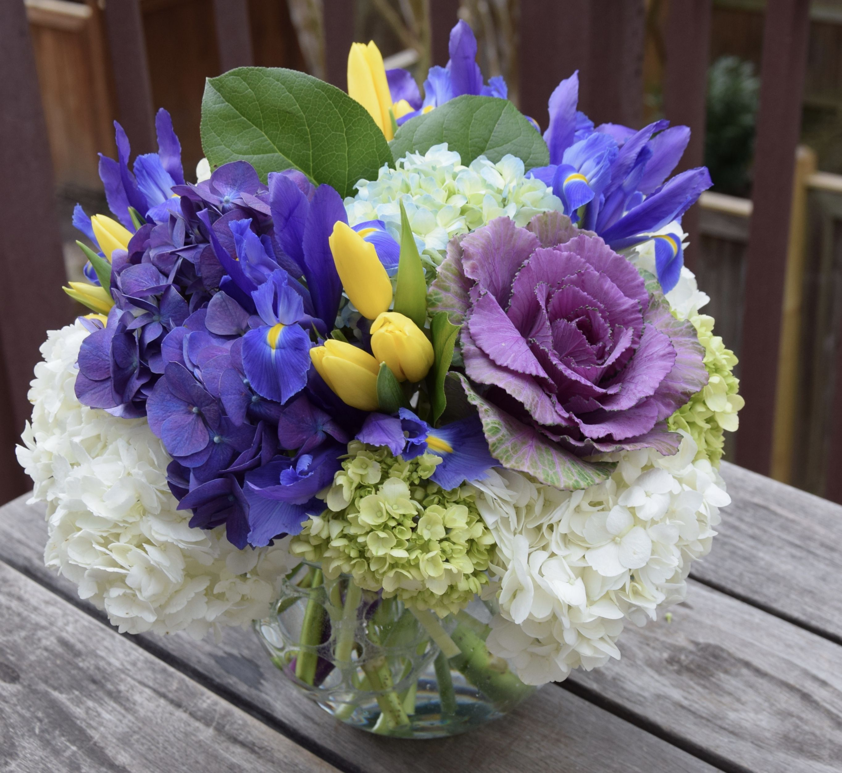 Masculine Flower Arrangement With Hydrangeas Irises Kale And Tulips Iris Flowers Iris Bouquet Flower Arrangements