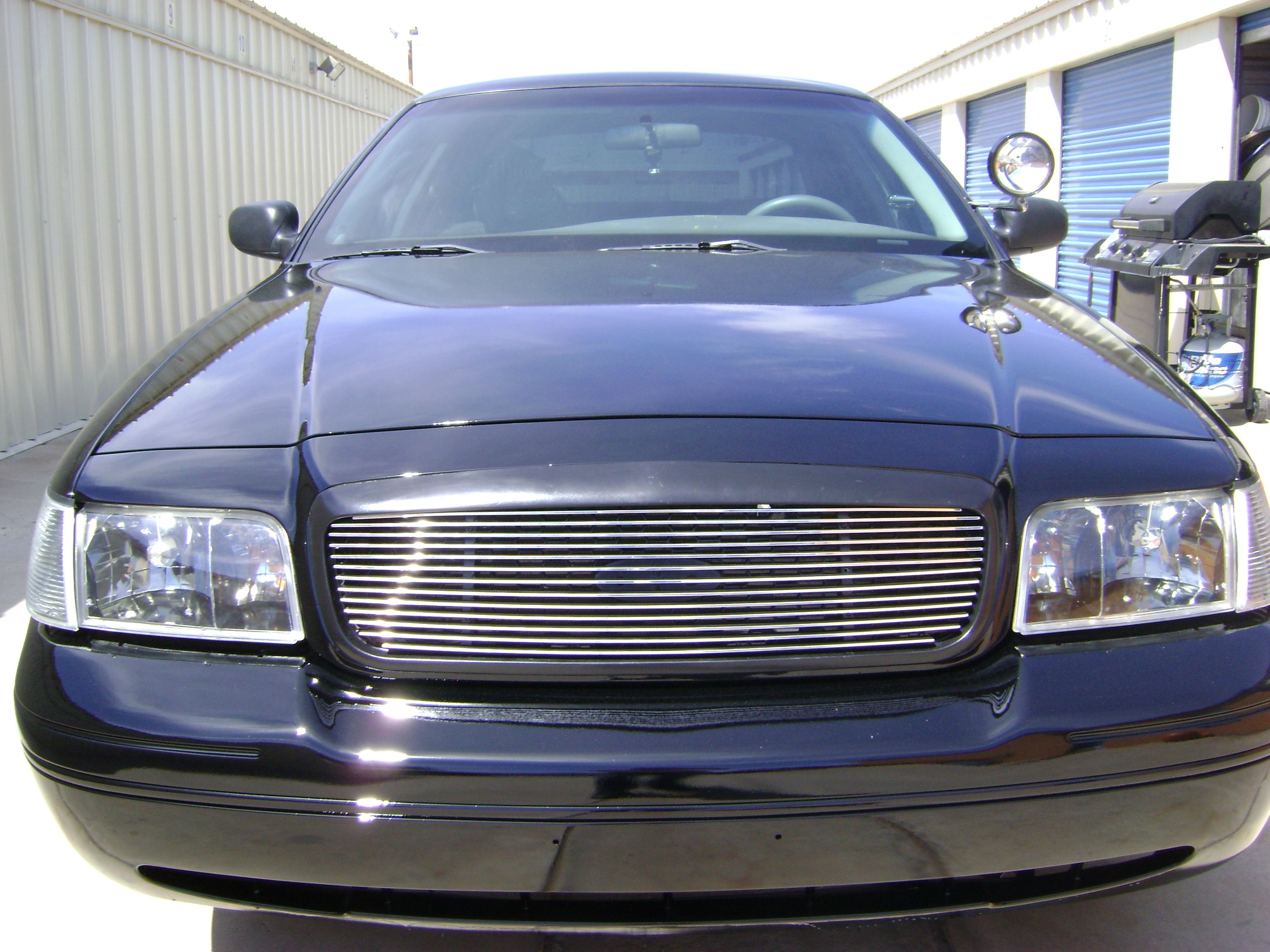 2000 ford crown victoria with polished billet grille by genx trims