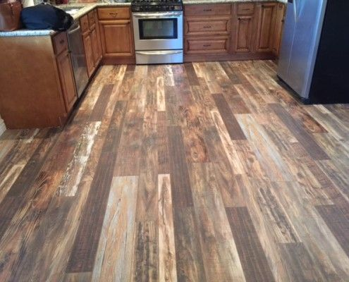 Laminate wood flooring in kitchen light medium and dark for Cheap flooring solutions