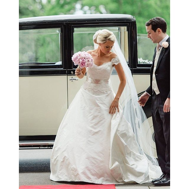 Real Brides Paloma Blanca: Bride Wearing A Paloma Blanca Gown.